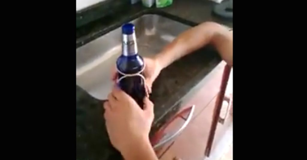 How to cut a glass bottle cleanly in half using a piece of for How to cut glass with string and fire